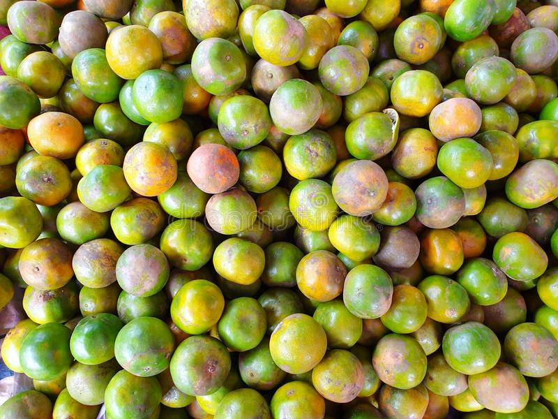 Top view of orange fruit as a background on market stand in Thailand stock photos