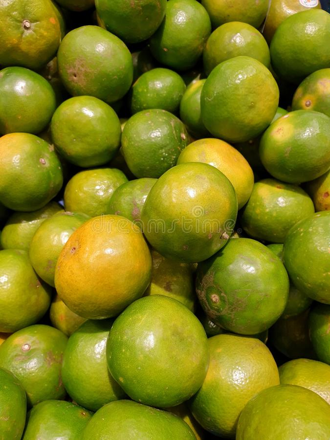 Top view of orange fruit as a background on market stand stock photo