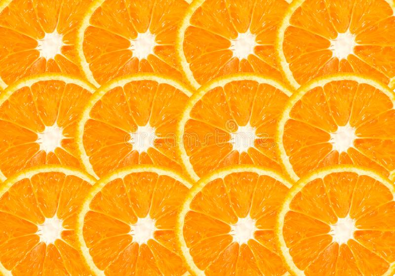Top view of orange slice fruit on color. Background stock photos