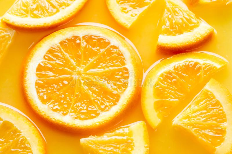 Orange slices in juice stock image