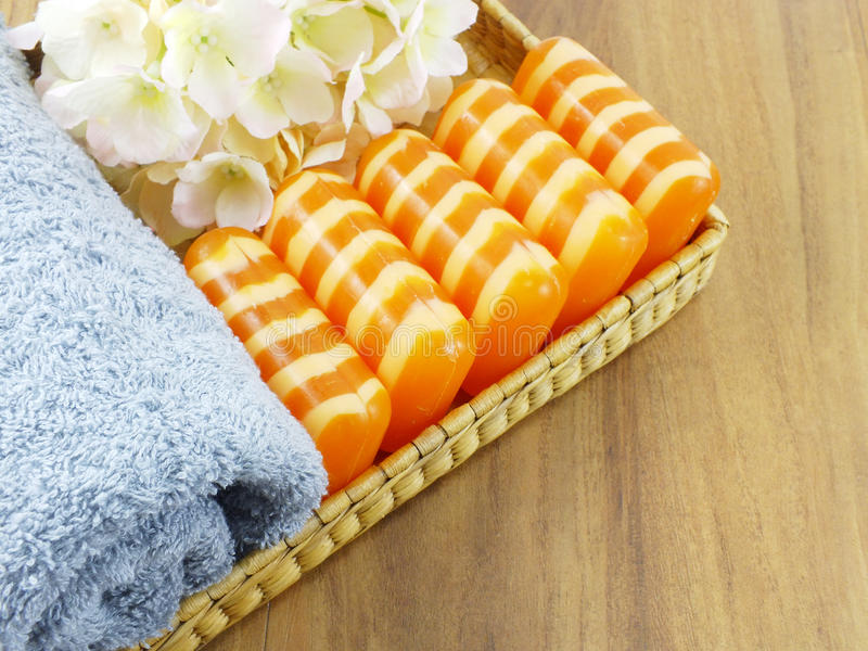 Top view orange soap with white stripes and towel. Orange soap with white stripes and towel stock image