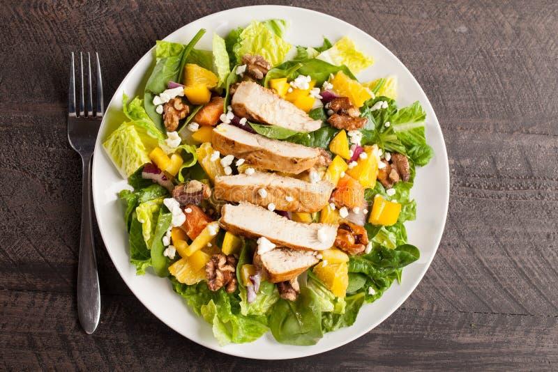 Top view of Orange Walnut Chicken Salad. Orange Walnut Chicken Salad on white platter top view stock photos