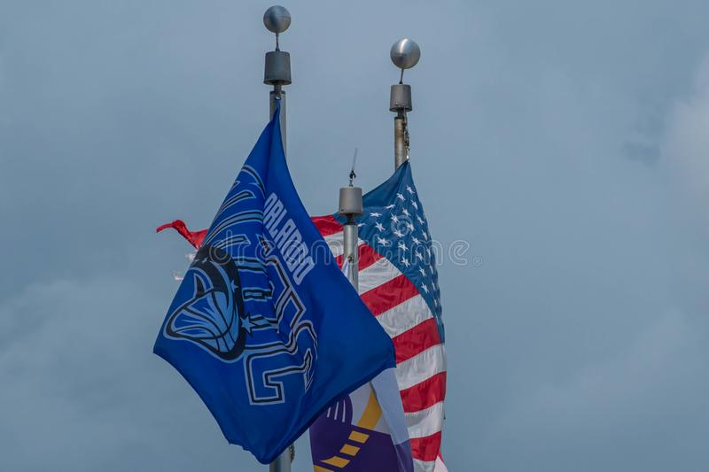 Top view of Orlando Magic, USA and Florida state flags at downtown area 88. stock image