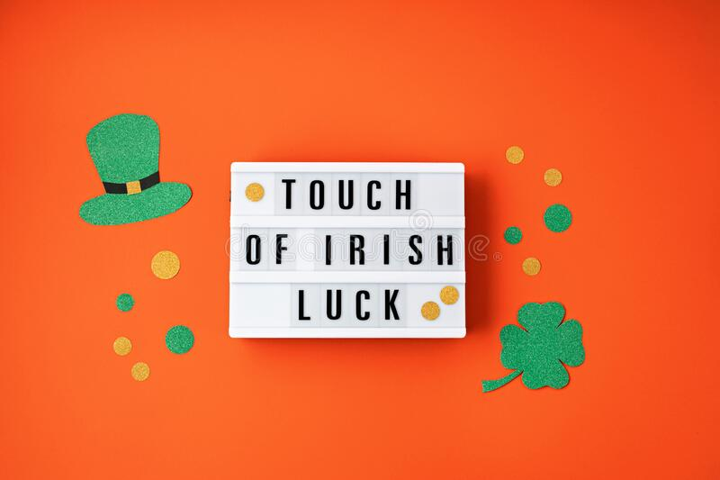 Top view over Saint Patrick day symbols in traditional colors. Greeting card, invitation, celebration idea royalty free stock images