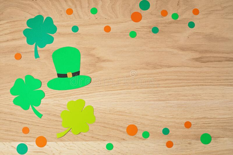 Top view over Saint Patrick day symbols in traditional colors. Greeting card, invitation, celebration idea royalty free stock image