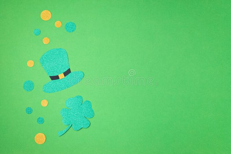 Top view over Saint Patrick day symbols in traditional colors. Greeting card, invitation, celebration idea royalty free stock photo