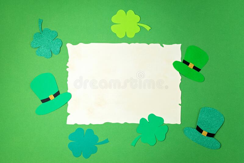 Top view over Saint Patrick day symbols in traditional colors. Greeting card, invitation, celebration idea stock photos