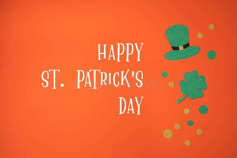 Top view over Saint Patrick day symbols in traditional colors. Greeting card, invitation, celebration idea stock photo