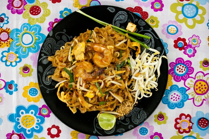 Top view of a Pad Thai plate at a street food stall at the weekend market, Phuket, Thailand. Top view of a Pad Thai in a black dish at a street food stall at the royalty free stock image