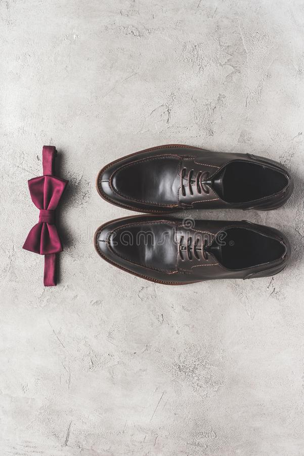 top view of pair of shoes and bow tie for wedding royalty free stock images