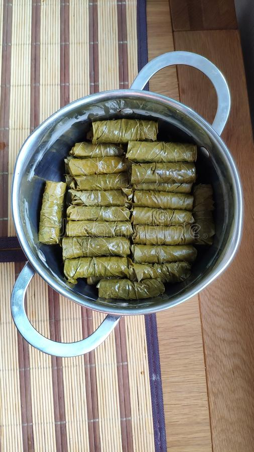 Top view pan with Dolma, tolma, sarma, dolmah stuffed grape leaves with rice and meat, traditional Caucasian, Ottoman, Turkish and royalty free stock images