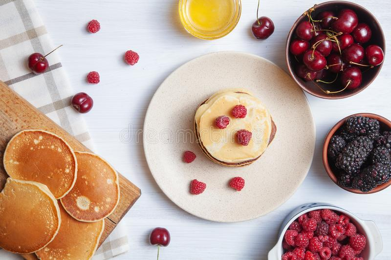 Top view pancake with summer berry on white background. Flat lay food for breakfast. homemade american pancakes with fresh sweet stock photos