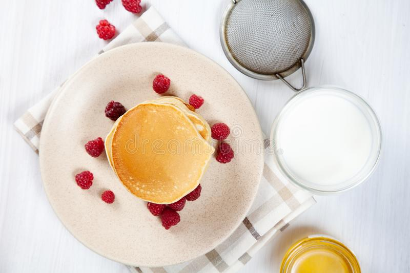Top view Pancakes with honey or marple syrup and berry for breakfast. Food for breakfast. Copy space for design. homemade american royalty free stock image