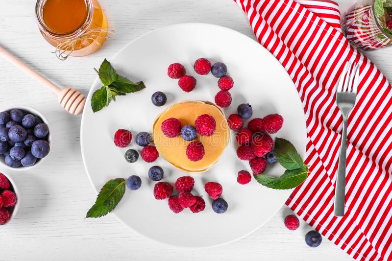 Top view of pancakes with raspberries and blueberries. Healthy summer breakfast,homemade classic american pancakes, morning light stock photography