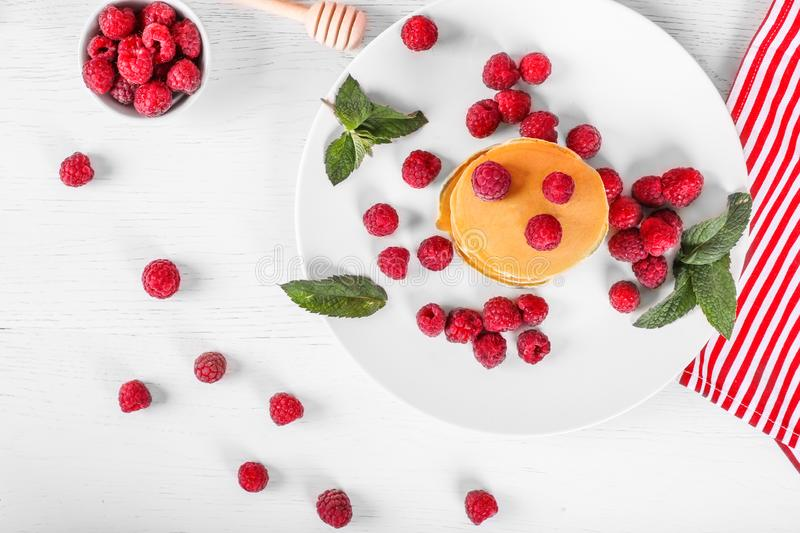 Top view of pancakes with raspberries on white wood background. Top view of pancakes with raspberries stock image