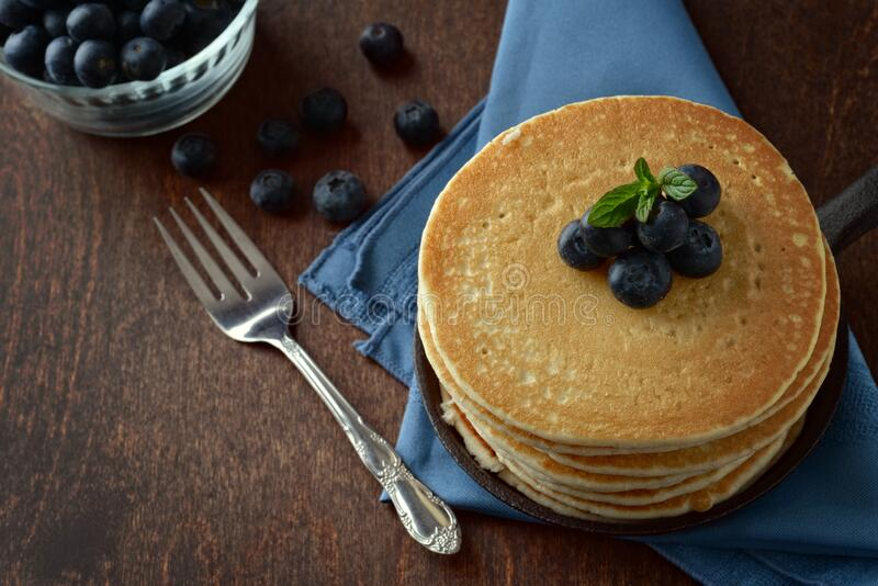top view pancakes in a skillet with blueberries stock images