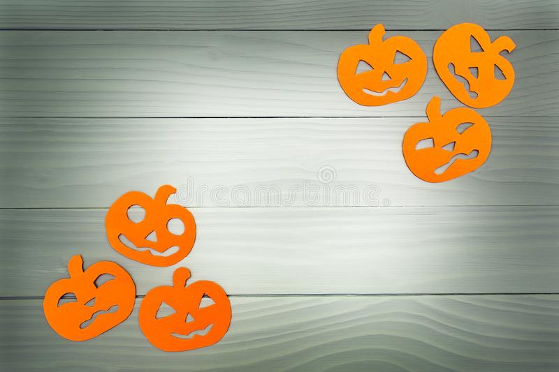Paper silhouette of six different pumpkin. Top view of paper silhouette of six different pumpkin made of vertical frame on grey wooden background. Halloween stock photography