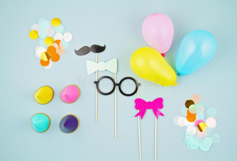 Top view of party accesories. Balloons, photobox accessories, confetti and party hats. Celebration, fun royalty free stock photography