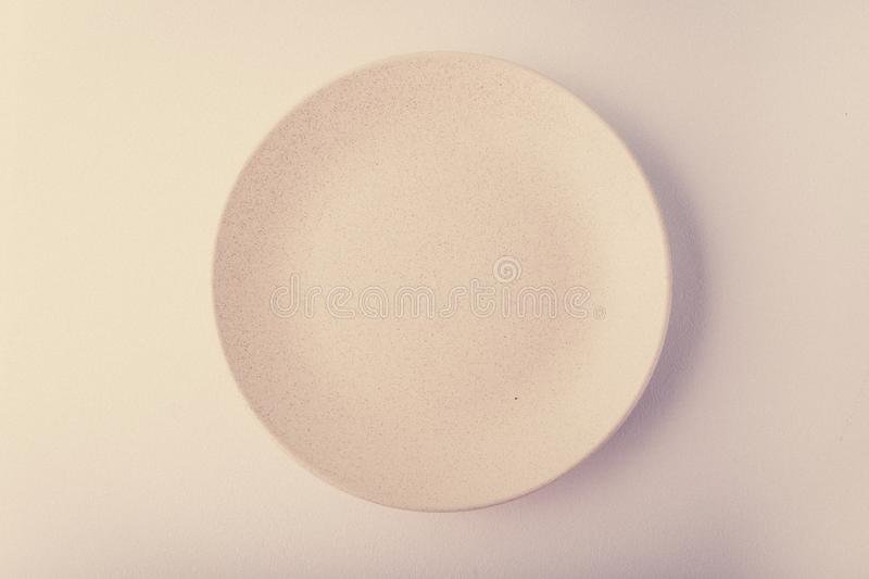 Top view of a pastel plate on a pastel peach background. Minimalism food photography. Geometric style. stock photos