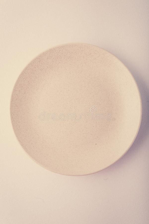 Top view of a pastel plate on a pastel peach background. Minimalism food photography. Geometric style. Copy space royalty free stock photos