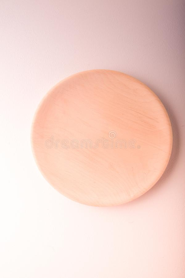 Top view of a pastel plate on a pastel peach background. Minimalism food photography. Geometric style. Copy space stock photos