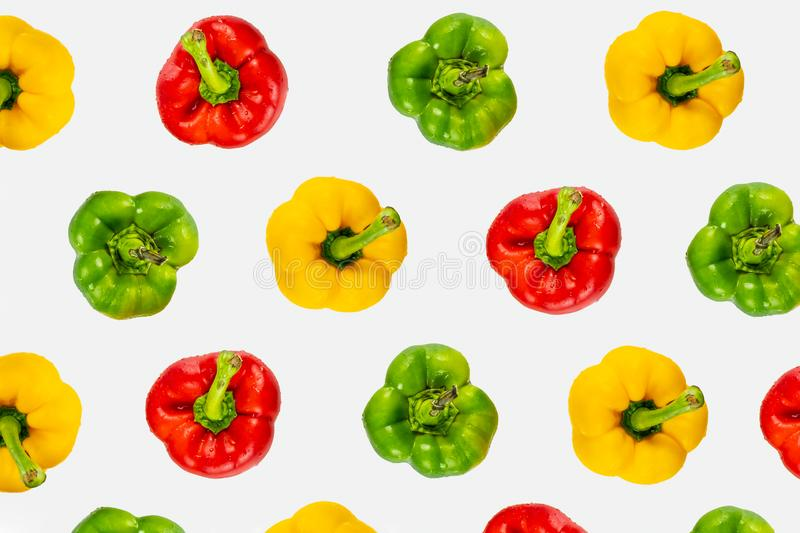 Top view pattern of fresh bright bell peppers on white background. Shot from above of multiple colorful paprika vegetables stock images