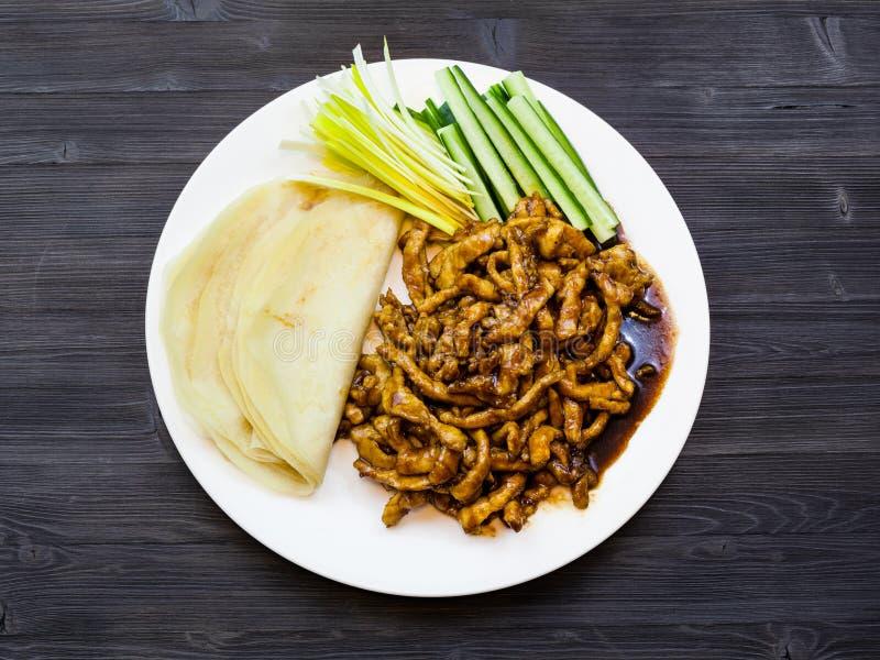 Top view of Peking Pork on plate on dark table stock image