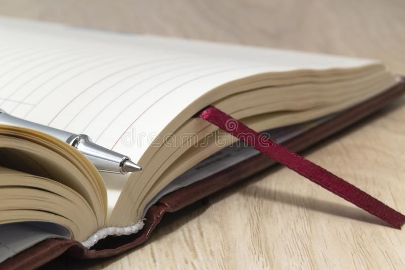 Top view - pen on an opened notebook close up royalty free stock photography