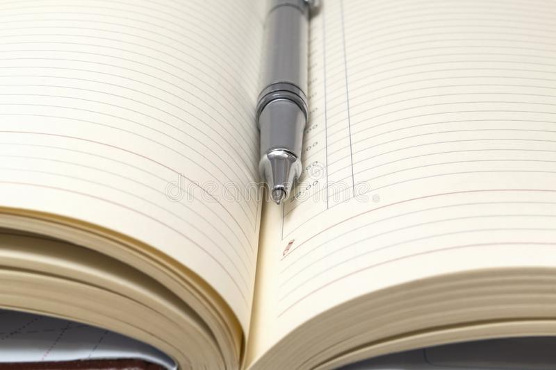 Top view - pen on an opened notebook close up stock photo