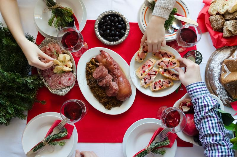 Top view of people enjoying Christmas dinner together royalty free stock photos