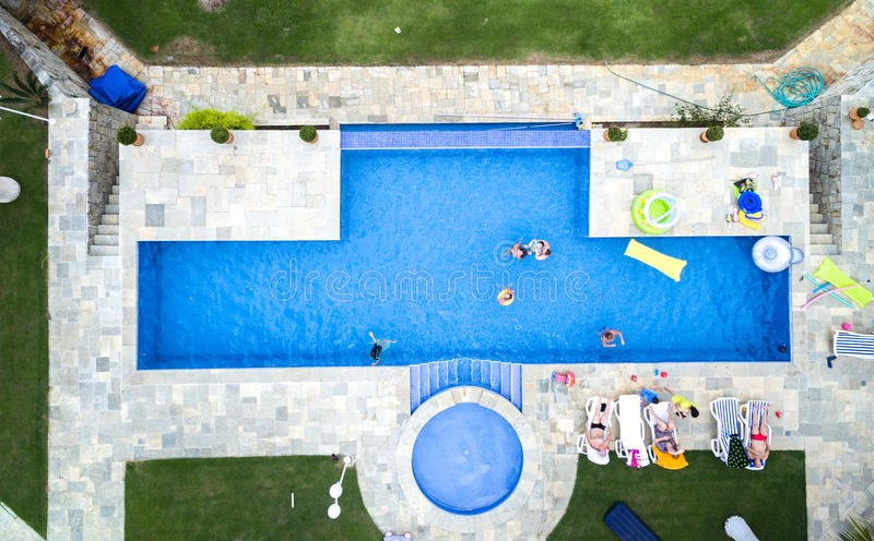 Download Top View Of People Enjoying The Swimming Pool Stock Photo