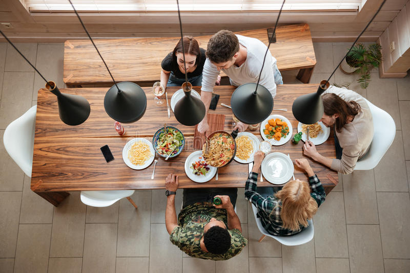 Top view of people having dinner together while sitting stock photography