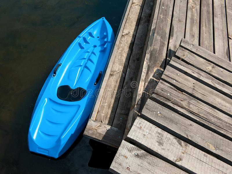 Top view photo of kayak near plank pier stock photos