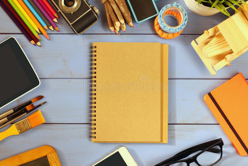 Top view photo of school supplies on wooden table royalty free stock photos
