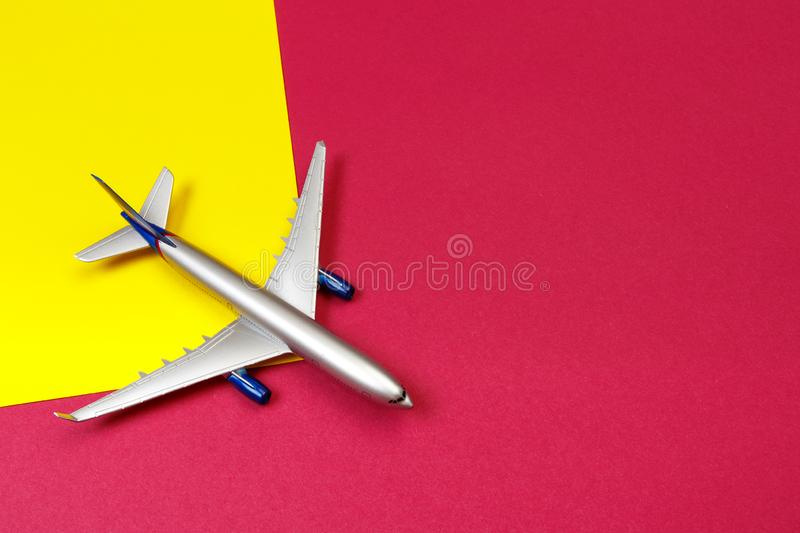 Top view photo of toy airplane over color  background . travel concept royalty free stock image
