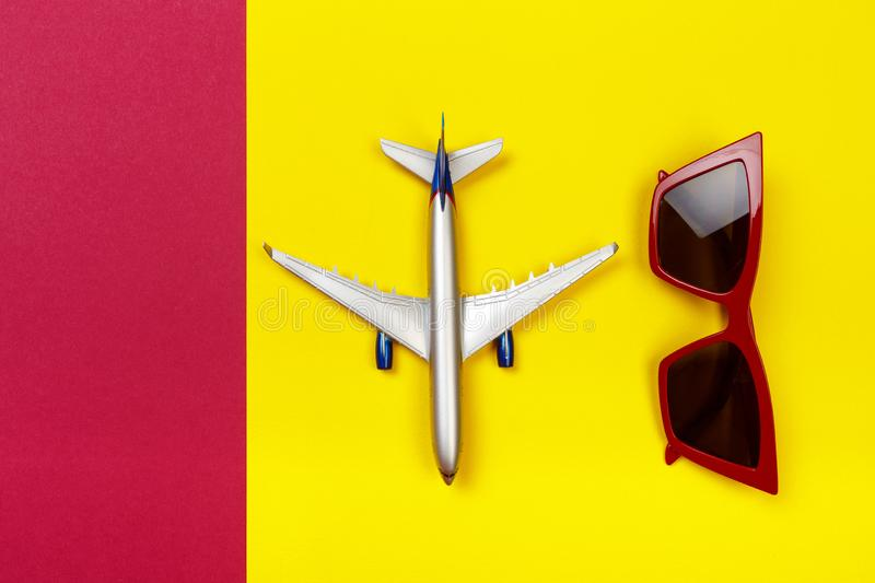 Top view photo of toy airplane over color  background . travel concept.  stock image