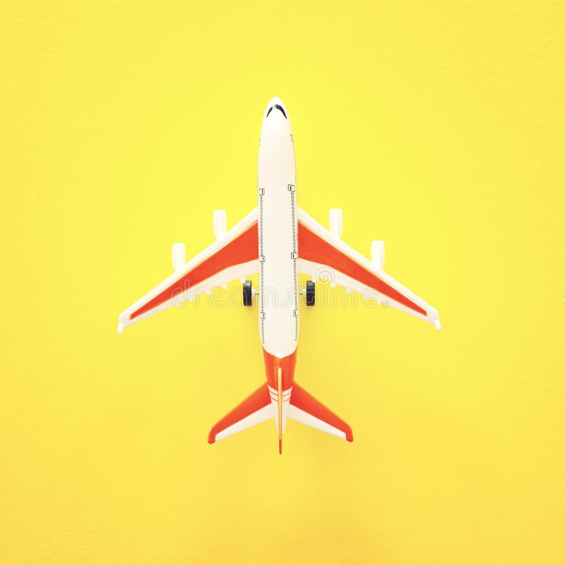 Top view photo of toy airplane over yellow background.  royalty free stock photo