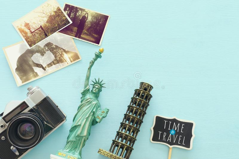 Top view photo of traveling concept with accessories and world symbols over blue background.  stock photos