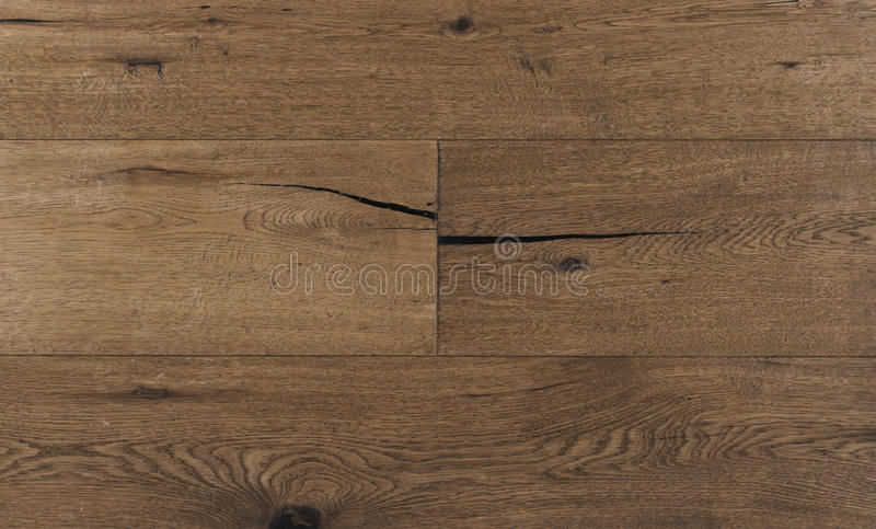 Top view photo of vintage rustic smoked Australian oak wood floor boards with rough texture, brushed and handscraped stock images