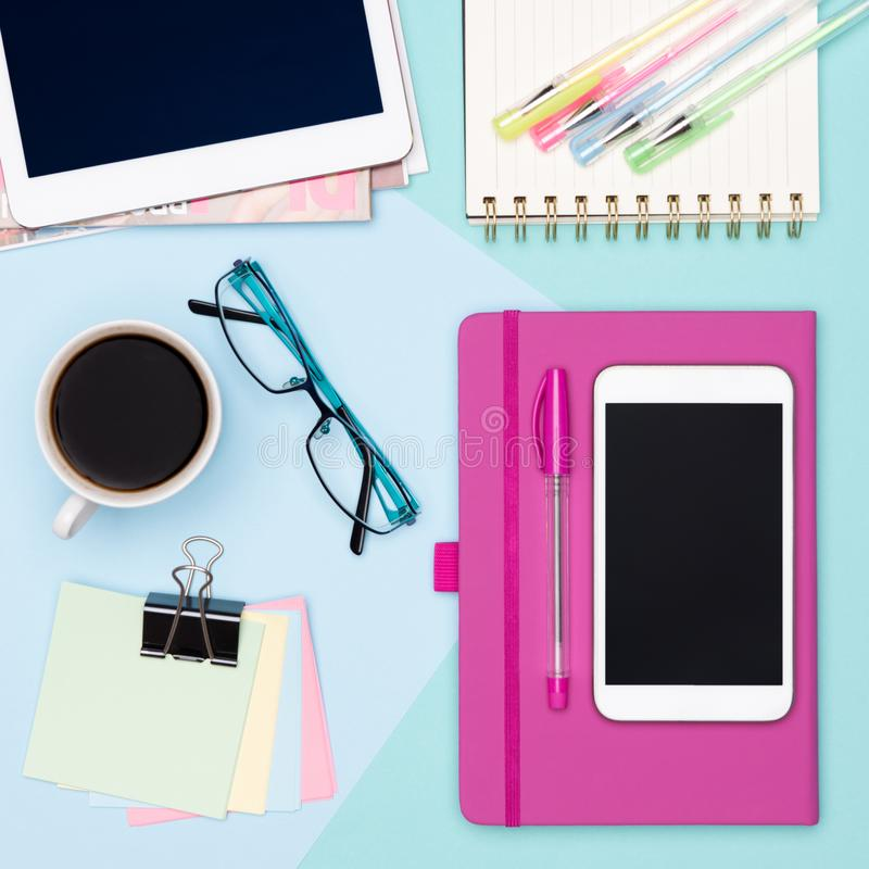 Top view photo of workspace with tablet and smartphone, coffee, notepad and woman fashion magazines. stock images