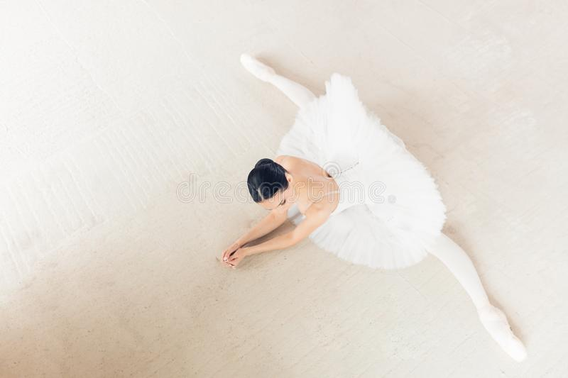 Top view photo. young ambitious ballerina doing splits exercise stock images