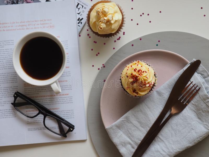 Top-view Photograph of Two Cupcakes, Cup, and Eyeglasses stock photography