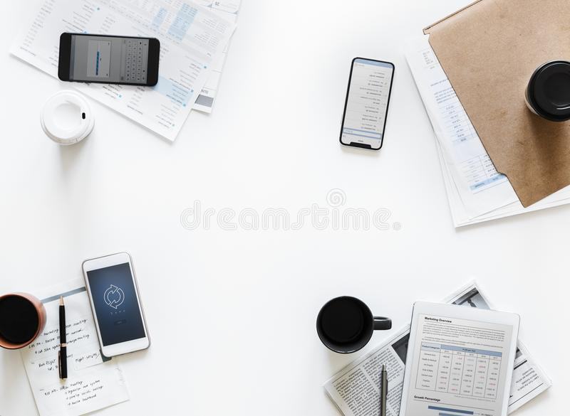 Top-view Photography of Smartphones and Papers on White Surface stock photo