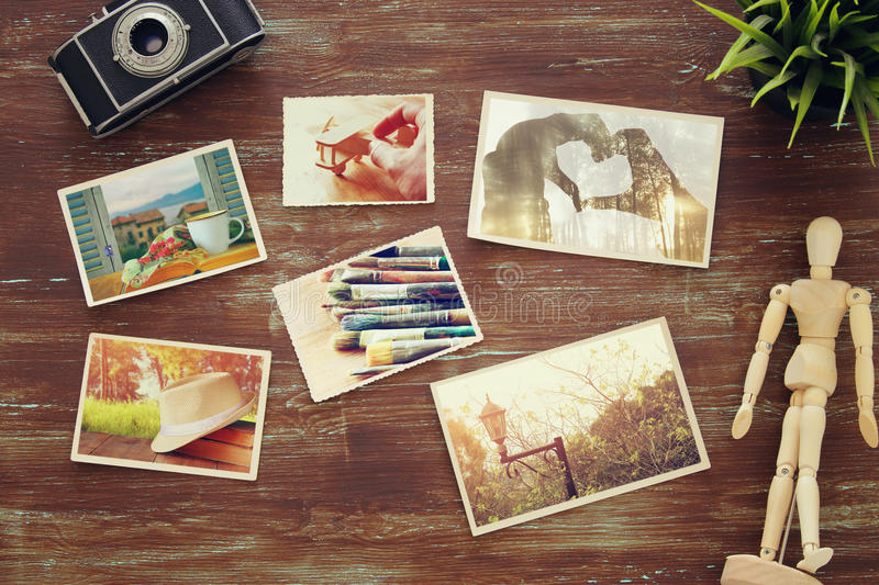 top view of photos collage on wooden background stock photography