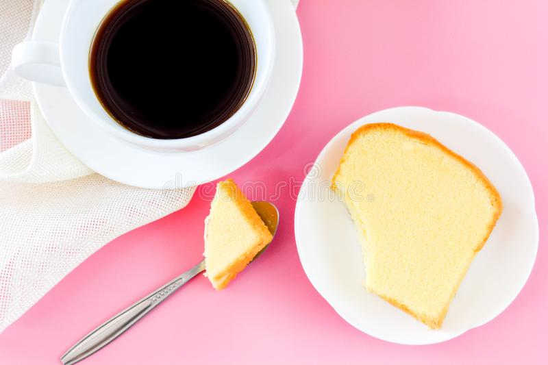 Top view piece of butter cake on white dish and metal spoon for eat and served with cup of black coffee. Times to relax concept. Background, baked, bakery stock photos