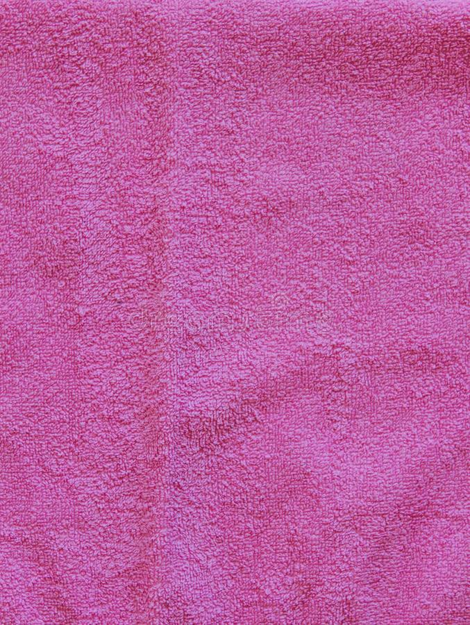Top view of Pink Towel texture. Pink Towel Fabric Texture Background. Close-up. Pink natural cotton towel background. Space for te royalty free stock image