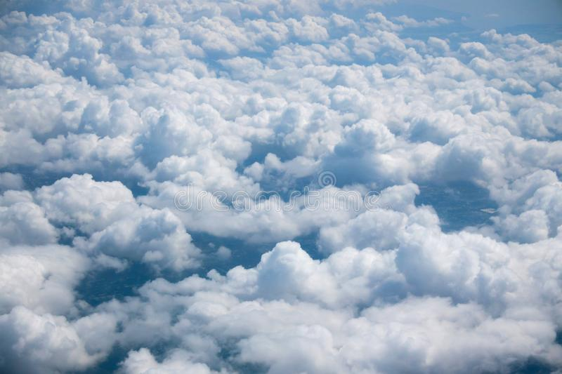 Top View from plane, Many clouds on sky. Blue sky background stock photography