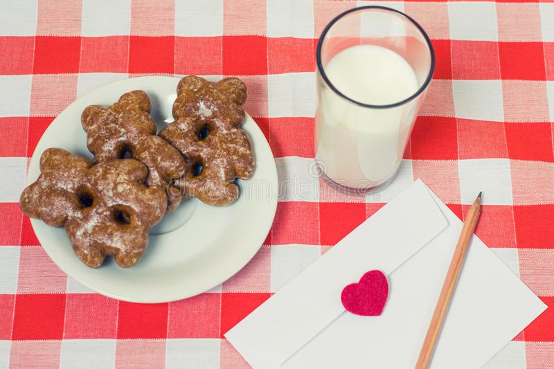 Top view of plate with cookies glass of milk and envelope with a stock images