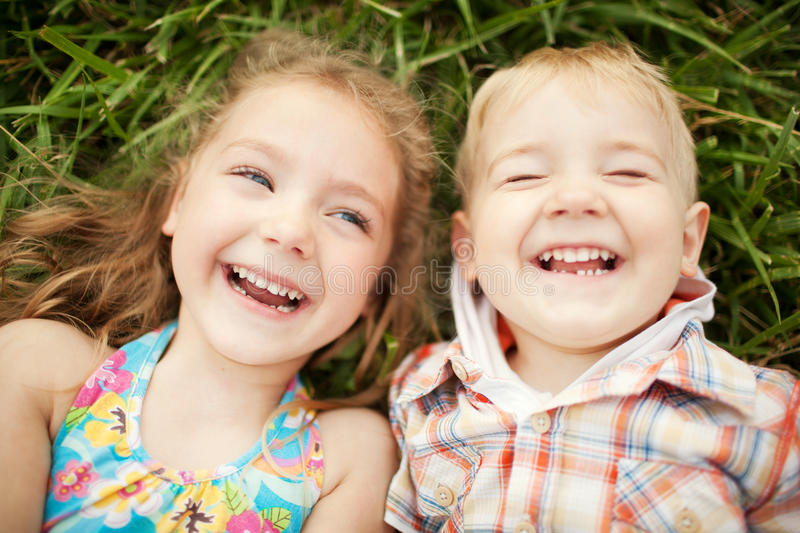 Top view portrait of two happy smiling kids lying royalty free stock photography