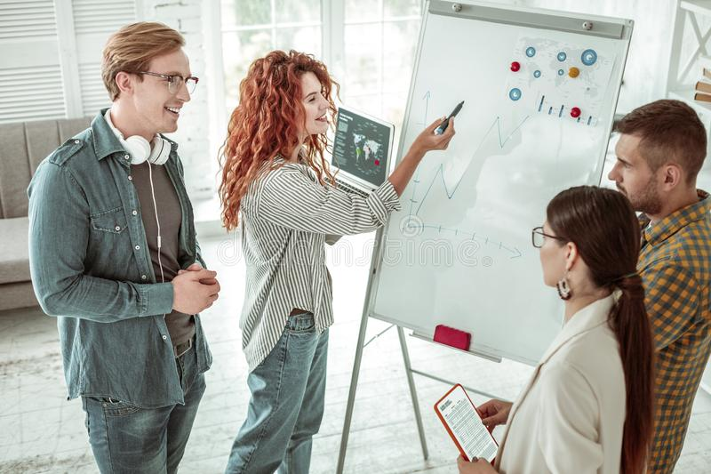 Top view of positive joyful people working together stock photo